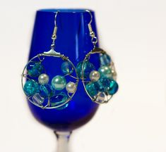 DIY Wire Hoop Earrings via Hopeful Honey... Think pearls in the sea... Aren't they lovely?!