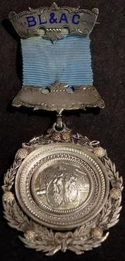 Everything Bicycles - c.1883 B.L. and A.C. Silver Award Medal with Two Ordinaries and Blue Ribbon