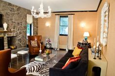Great chandelier and mirror, especially juxtaposed with the rugged rock wall.