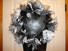 """GOD GAVE ME YOU""...abstract black and white wreath with heart shaped chalkboard, contrast ribbons and florals."