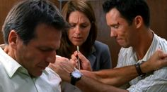 """That green chair in my loft was my favorite."" [Michael Westen] (did it survive the fire in the loft?) Pictured: Michael Westen (Jeffrey Donovan), Agent Jason Bly (Alex Carter) and Paula Foster (Mandy June Turpin)"