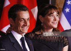 French President Nicolas Sarkozy and his wife Carla Bruni-Sarkozy are pictured at Baden-Baden City hall on April 3, 2009 as they prepare to greet heads of delegations during the NATO summit. The summit, which marks the organisation's 60th anniversary, is taking place on April 3 and 4, 2009 in Strasbourg, France and the neighbouring German cities of Baden-Baden and Kehl.AFP PHOTO DDP / MICHAEL URBAN