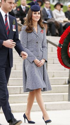 #Middleton! donned a navy and white tweed Michael Kors coatdress, Jonathan Howard fascinator, Russell and Bromley clutch, and chic suede pumps.