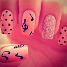Nail Art with music notes, polka-dots & sparkle! This nail art is a combination of all 3 nail designs in one....sparkle nail polish on ring fingers and polka-dots & music notes w/treble clef on the other nails... Nice, simple design!