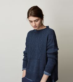 Easy, slightly swingy, Guernsey pullover in a weighty, textured wool/linen. Ribbed, rolled edge neck. Dropped shoulders. Long sleeves. Split hem.