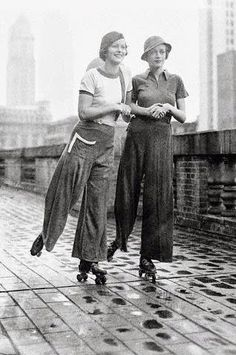 "1933 Theresa Townsend and Joan Hamilton - Manhattan, New York - The jersey ""sylo-pyjamas"" in red, white and blue during a period of skating on the roof of Roosevelt Hotel - Photo by Otto Bettmann"