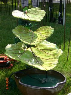 Fountain made from 3 cast concrete rhubarb leaves