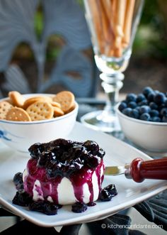 Goat Cheese w/ Blueberry Vanilla Compote - Blueberry Vanilla Compote: Use fresh or frozen blueberries, both will work beautifully. Serve it over goat cheese, ice cream, yogurt, or pancakes (whatever strikes your fancy), for a taste of summer all year long. (Makes 1 cup) INGREDIENTS: 1 cup blueberries 1/4 cup apple juice 1/2 cup granulated sugar 1 teaspoon vanilla