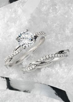 Best Diamond Engagement Rings : This platinum engagement ring features a delicate twist of pavé-set diamonds th. - Buy Me Diamond Wedding Rings Simple, Wedding Rings Solitaire, Beautiful Wedding Rings, Platinum Engagement Rings, Wedding Rings Vintage, Bridal Rings, Wedding Jewelry, Engagement Rings Twisted Band, Halo Engagement