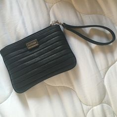 Black leather wristlet Brand new black leather wristlet. Fits phone and credit cards and keys perfectly. It's the perfect size! Express Bags Clutches & Wristlets