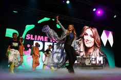 Delta Goodrem Photos Photos - Delta Goodrem walks onto the stage during the Nickelodeon Slimefest 2016 evening show at Margaret Court Arena on September 25, 2016 in Melbourne, Australia. - Nickelodeon Slimefest 2016 - Melbourne: Show