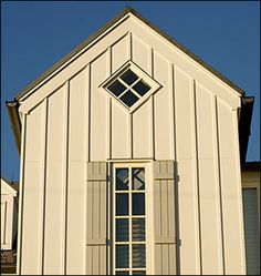 5 Winning Details Board and Batten Siding - Best New Home: Five Winning Details - Southernliving. More than just a way to sheathe the exteriors, the board and batten siding also establishes the rhythm and unit of measurement by which Board And Batten Exterior, Board And Batten Shutters, Exterior Remodel, Exterior Siding, Exterior Colors, Exterior Design, Siding Colors, Garage Design, Exterior Paint
