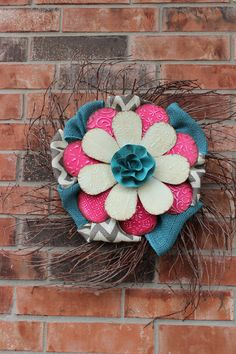 Radiantly Redeemed- Grapevine wreath with flower and burlap accents.