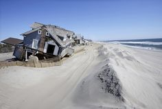 Homes severely damaged last October by Superstorm Sandy, are seen along the beach Thursday, April 25, 2013, in Mantoloking, N.J.
