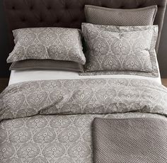 coordinate different patterns, duvet cover, quilt, decorative pillows....like this