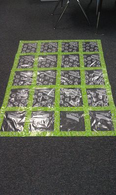 DISPLAY PROJECTS: Gallon Ziploc bags + Duck tape = A Wall Quilt! Students' work slides in the back. You won't see where it says Ziploc because that is on the back side!