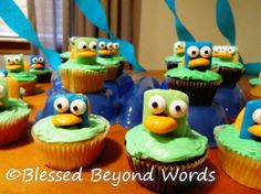 I made these cupcakes for my son's birthday party, and they were super cute.  I used all blue airheads on green icing.