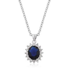 This beautiful pendant features an oval shaped sapphire color crystal mounted on a crown of pave clear CZ with lustrous pave clear zircon sh...