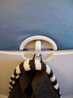 Most airplanes have a little hook at your seat. AMAZING.