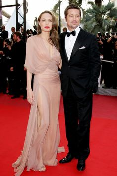 Angelina Jolie and Brad Pitt at Cannes in 2009 wearing Versace