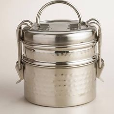 Our stylish Hammered Metal Tiffin Lunch Box is crafted in India with multiple compartments secured by a latched lid. Its lasting durability and ample space make this unique Indian-style lunch box ideal for potlucks, picnics and camping trips. Food Box, Tiffin Lunch Box, Lunch Boxes, Box Lunches, Tiffin Carrier, Lunch Box With Compartments, Co2 Neutral, Boite A Lunch, Metal Lunch Box