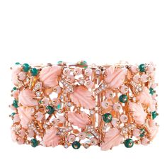 This 18k rose gold bracelet by the historic Neapolitan house De Simone was inspired by the idea of heaven or paradise. The bracelet is decorated with hand-carved leaves made of angel skin coral, as well as emeralds and diamonds - a combination which results in soft yet striking femininity.
