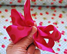 Bow tutorial. Make a hair bow, but use it as your gift bow and use excess ribbon to wrap with.
