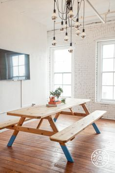 """An Art Studio's Weird and Wonderful Office Design - """"The whole space was given a fresh coat of white paint which made the already bright space even brighter and added pops of color that definitely reflect the fun, creative company they are.  We updated all the lighting to pendant lighting and did some major organization!"""" - @Homepolish Brooklyn"""