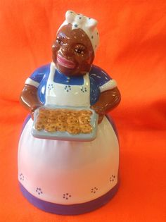 Black Americana Mammy Cookie Jar Holding Tray of Cookies