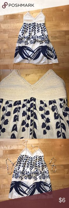 NWOT cream blue medium tank crochet sheer top NWOT never worn. cream color with dark blue. Size medium tank with crochet chest and straps. Has a liner so crochet isn't see through. This isn't fully sheer but it's thin on the bottom. Papaya Tops Tank Tops
