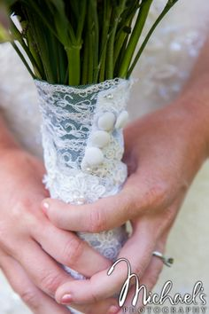 Lace from the bride's grandmother's wedding gown added to her bouquet. A great way to keep Gram with you :)