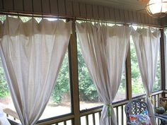 Add instant shade to your porch with this canvas drop cloth curtain tutorial
