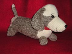 Oscar is handcrafted by me out of a pair of Vintage Red Heel socks. Measuring around 16 inches long, they have embroidered eyes and a felt nose or plastic animal eyes and nose. You have a choice. He has a red braided collar. Oscar would be a perfect gift for anyone with a Dachshund, or a sock monkey doll collector. All of my customers have been very pleased with their purchases and I promise you will be too.