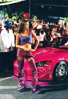 Pin for Later: The Fast and the Furious Nostalgia: Go Back to the Beginning With These Pictures 2 Fast 2 Furious (2003) Devon Aoki pops up as female racer Suki.