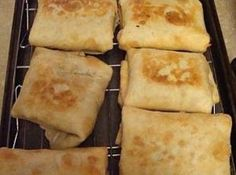 """Baked Chicken Chimichangas Recipe Stir together cream cheese, Pepperjack cheese and taco seasoning. Fold in chicken. Divide among flour tortillas. Tuck in sides, and roll up each tortilla. Lay seam side down in a sprayed 9x13"""" baking dish. Spray tops of tortillas with cooking spray. Bake at 350 for 15 minutes. Turn chimi's over, and bake an additional 15 minutes. Serve with cheddar cheese, green onions, sour cream, and salsa."""