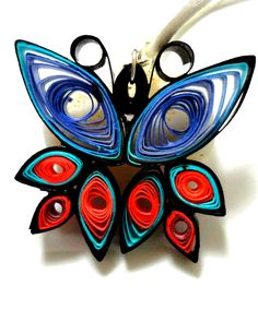Quilled butterfly in black, blue, purple and pink, paper filigree. $15.00, via Etsy.