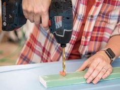How to Create a Budget-Friendly Jewelry Organzier | HGTV Diy Jewelry Cabinet, Diy Jewelry Hanger, Building A Door, Build A Wall, Perforated Metal, Decorative Knobs, Create A Budget, Rustic White, Wood Glue