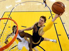 Timofey Mozgov goes up for a shot against Festus Ezeli.