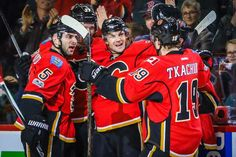 SHOOTING FLAMES: Michael Frolik of the Calgary Flames, center, celebrates his goal with teammates against the Dallas Stars during the first period at Scotiabank Saddledome in Calgary, Alberta, on March Nhl Season, First Period, My Man, Calgary, Motorcycle Jacket, Goal, Seasons, Celebrities, Celebrity
