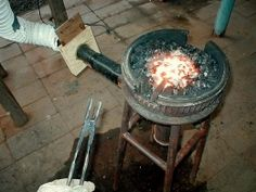 Forge - Homemade forge constructed from a surplus brake drum, pipe, and steel plate.
