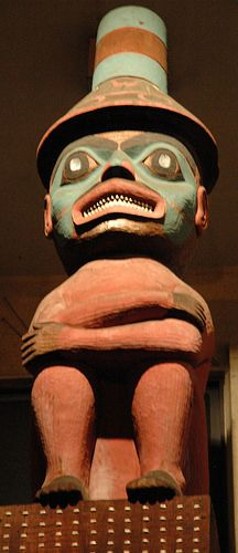 Chattering teeth - wow it's chilly, important person, tall hat, abalone eyes, ochre red, turquoise and black pigment, totemic design, northwest, Erna Gunther Ethnobotanic Garden, University of Washington campus, Seattle, Washington, USA