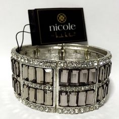 Nicole Miller Grey Crystals Stretch Cuff Bracelet Brand new with tags. This Nicole by Nicole Miller Stretch Cuff has grey rectangular crystals adorned by white round crystals. Very elegant! Nicole by Nicole Miller Jewelry Bracelets