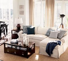 Living Room, : Engaging Image Of Living Room Decoration Using Nautical Accent Blue And White Sofa Pillow Including L Shape White Cloth Living Room Sofa And Rectangular Solid Cherry Wood Drawer Coffee Table