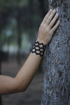 This bracelet is made with the macrame technic, knot after knot, just using my hands and waxed thread! The design is suitable for those who love geometric patterns, gothic style and special jewelry... If you want to be special,get this, and be sure that you wont be forgotten!!! Color:Black