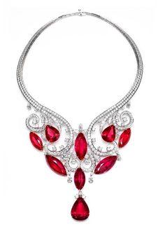 Rubini birmani, raffinata lavorazione in platino e diamanti...