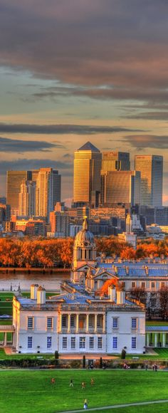 From the Greenwich Observatory - Canary Wharf forms the backdrop for the Old Royal Naval College, Greenwich, London, UK