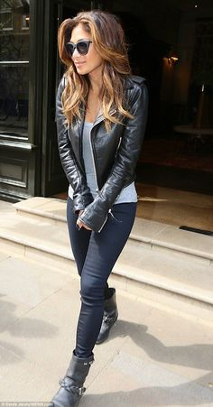 Nicole Scherzinger seemed to be embracing her inner rock chick by sporting this cute, fitted leather jacket and matching ankle boots!