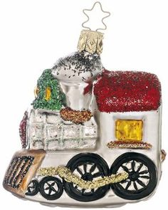 """Santa's Shiny Steam Engine. 3-1/2"""" glass ornament. Retired 2011.  Hand-blown, hand-painted. From Inge Glas studios in Neustadt, Germany."""