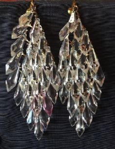 "Crystal chandelier earrings. Two dozen Lucite prisms electrify your red carpet look. 2"" wide, 4.5"" long."