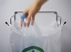 Garbage bag hook to reuse old plastic bags -- should be easy to DIY from old wire hangers.